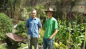 Enjoying the NUI Permiculture Garden.  Founder of the Community Exchange System Tim Jenkins with son Aran.